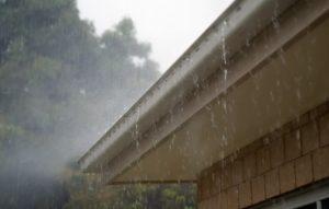 rain overflowing gutters